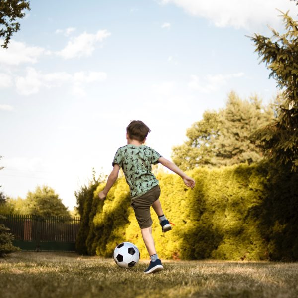 low-angle-photo-of-a-boy-playing-soccer-2682543